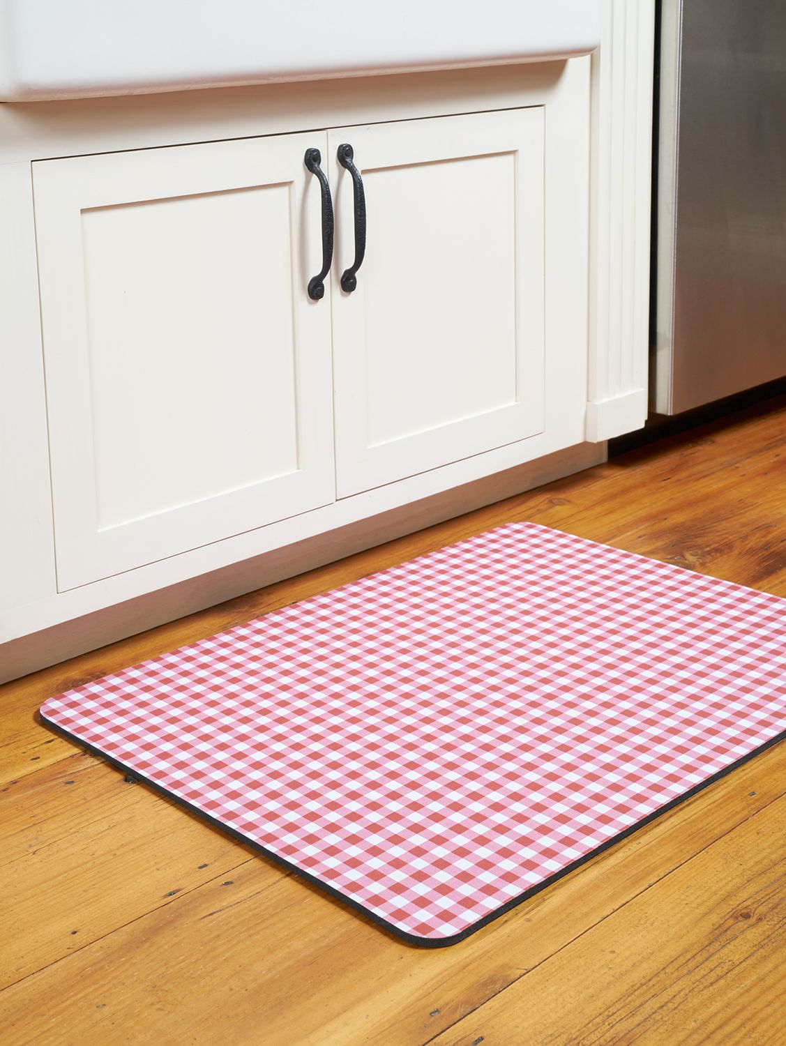 Cushioned kitchen mats with skid resistant backing